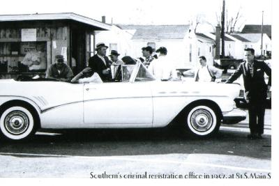 Photo, Larry Tribble Sr, standing behind auto, 1957, Southern Auto Auction at first site, 81 So. Main St., Warehouse Point.