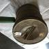 Flour sifter, tin, with green handle.