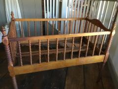 Crib, baby. Spidles. Purchased by Olin and Miriam Watson Osborn (grandfather to Richard Osborn).