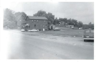 Hall & Muska Gas Station and Barber Shop, Main Street Broad Brook (Photo of where it once stood). Moved February 1, 1967 to the back of the museum.