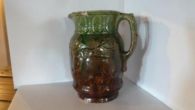 Pitcher, ceramic, green/reddish-brown, with image of half-man/half-beast.
