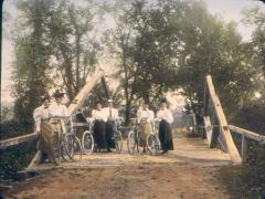 Bicyclers on Wooden Bridge