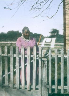 Woman by Fence
